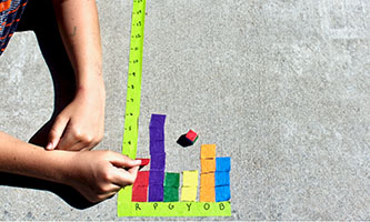 Colorful masking tape bar graph on concrete